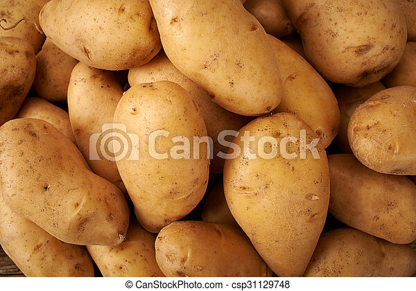 many potato on wooden kitchen table