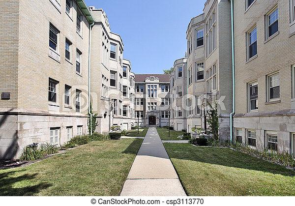 Condominium building with long walkway - csp3113770