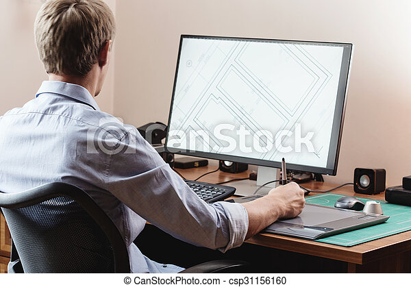 Graphic designer using digital tablet and computer in office or home - csp31156160