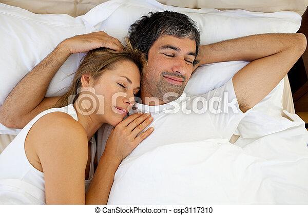 Positive couple sleeping