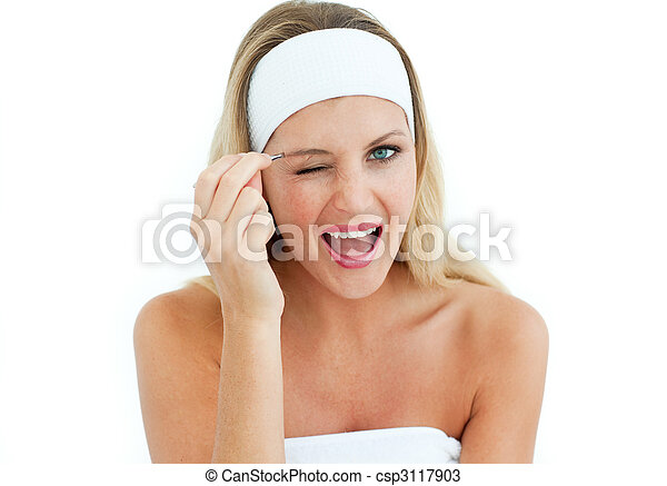 Young woman using tweezers - csp3117903