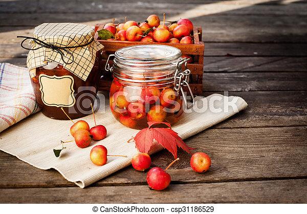 Apple jam in jar and apple fruits. Autumn still life.