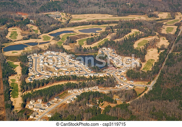 Aerial view of a golf course and housing development - csp3119715