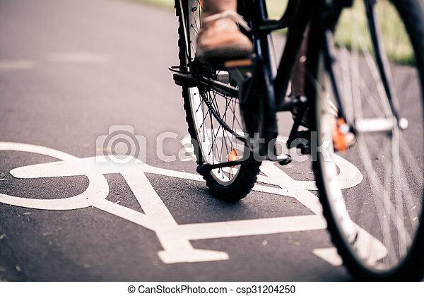 City bicycle riding on bike path