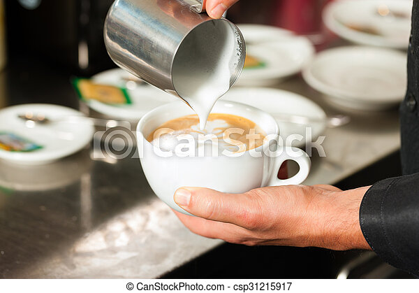 Barista making cappuccino in his coffeeshop