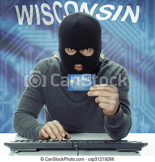 Dark-skinned hacker with USA states flag on background holding credit card - Wisconsin - csp31219266