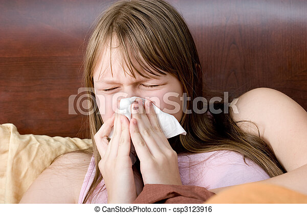 Sick with flu teenager girl in bed sneezing , allergies , illness. - csp3123916