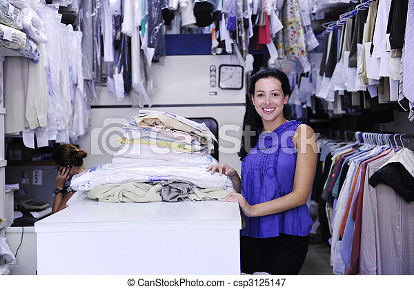 happy owner of a dry cleaning service - csp3125147