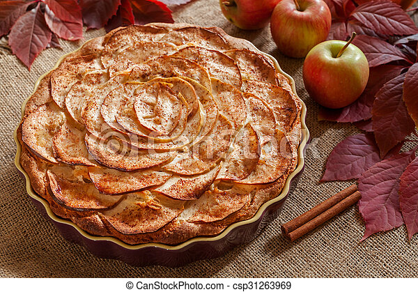 Homemade gourmet apple pie baked sweet traditional dessert with cinnamon and apples on vintage background.