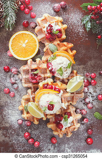 Waffles with ice cream and oranges