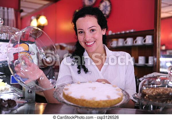 owner of a small business store showing her tasty cakes - csp3126526