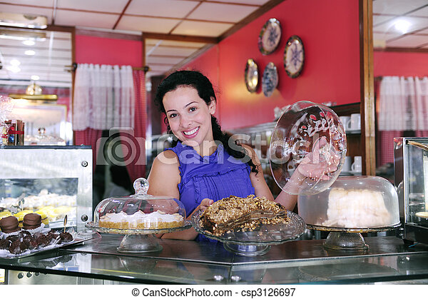 owner of a small business store showing her tasty cakes - csp3126697