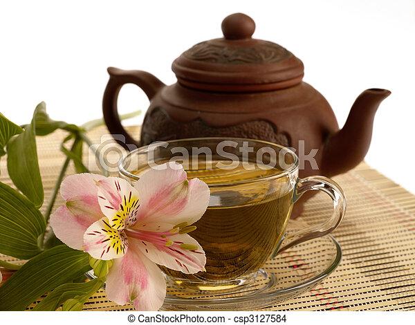 tea ceremony. Green tea, flower and teapot - csp3127584