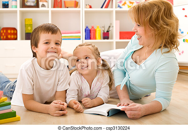 Kids having fun reading stories with their mom - csp3130224