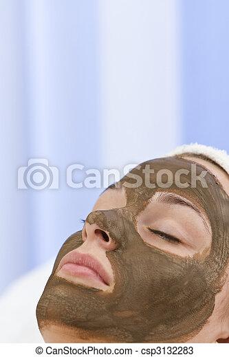 Young Woman Having Chocolate Face Mask Facial At Health Spa - csp3132283