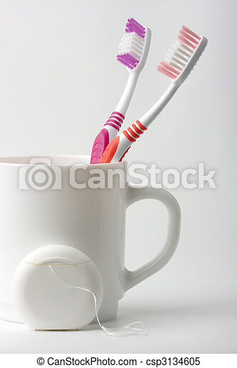 Two toothbrushes in a cup and dental floss - csp3134605