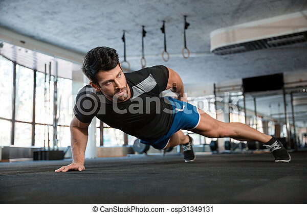 Handsome man doing push ups exercise