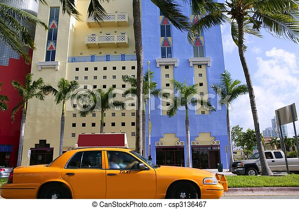 Yellow cab with Miami Beach Florida buildings - csp3136467