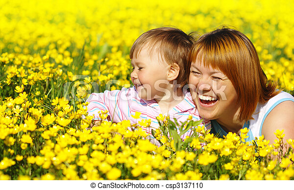 Mother and child play on meadow - csp3137110