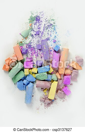 Colorful chalk broken colors mess over white - csp3137627