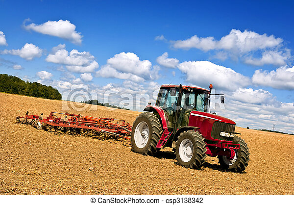 Tractor in plowed field - csp3138342