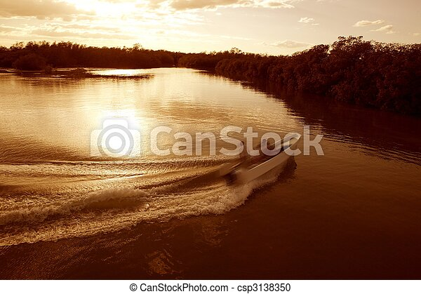 Boat ship wake prop wash sunset lake river - csp3138350