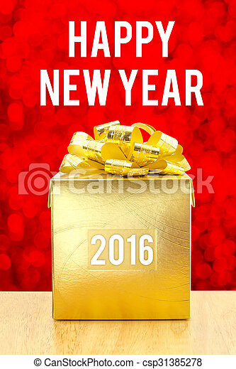 Golden Present box on wood table with Happy New Year 2016 word at bokeh light background, Holiday concept