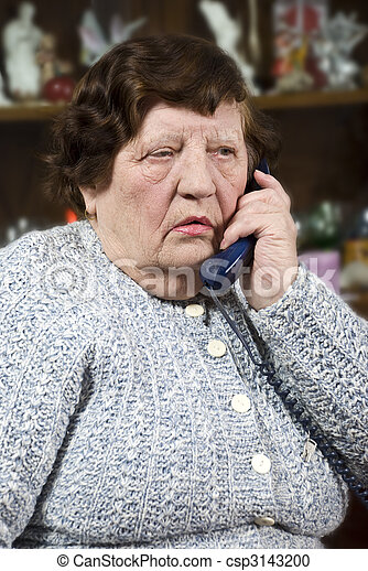 Elderly woman speaking at phone - csp3143200