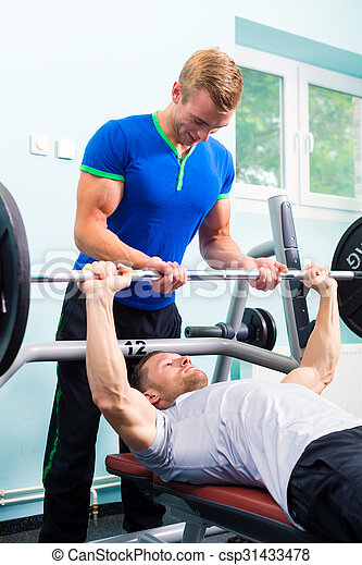 Men in sport gym training with barbell for fitness - csp31433478