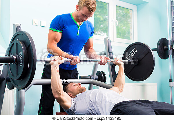 Men in sport gym training with barbell for fitness - csp31433495