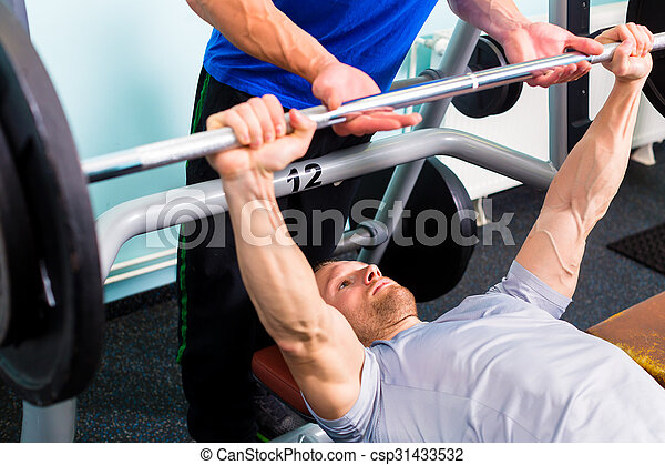 Men in sport gym training with barbell for fitness - csp31433532