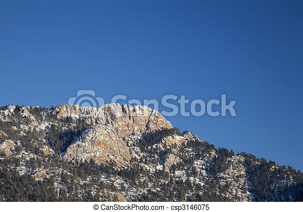 Horsetooth Rock in winter scenery - csp3146075