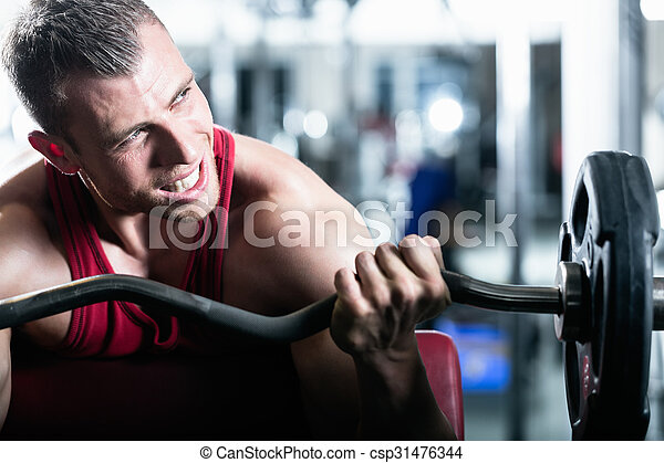 Dumbbell training in gym - csp31476344