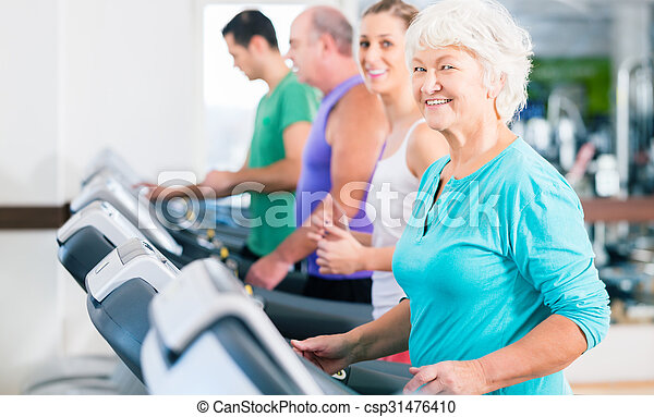 Group with senior people on treadmill in gym