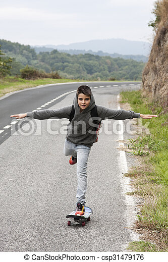 child with skateboard outdoors