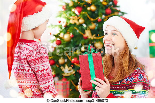 happy family at Christmas. mother and child give gifts