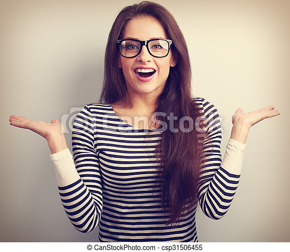Beautiful excited woman in glasses with natural surprising emotions gesturing the hands