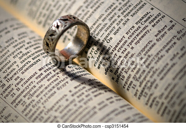 holy bible with silver ring and heart shape shadow - csp3151454