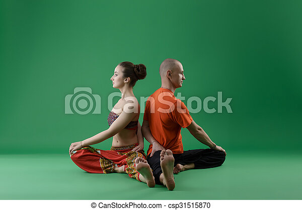 Yoga. Man and woman sitting backs to each other