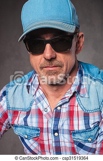senior casual man wearing baseball hat and sunglasses