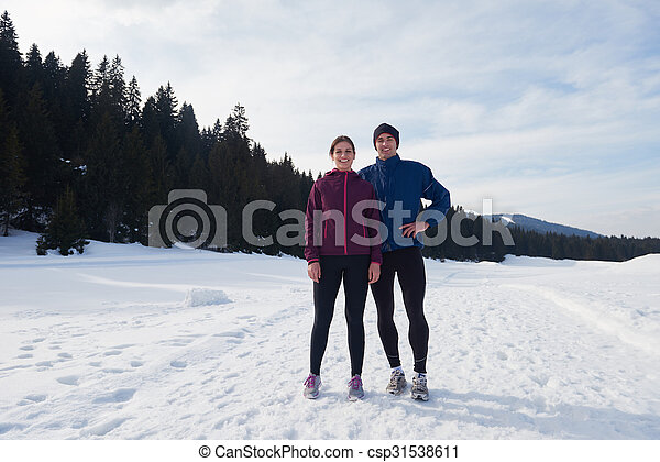couple jogging outside on snow