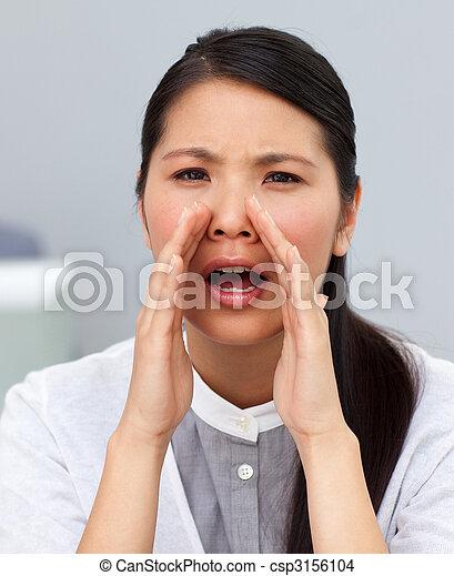 Attractive businesswoman yelling - csp3156104