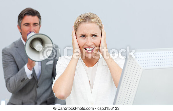 Competive manager shouting in a megaphone to his colleague - csp3156133