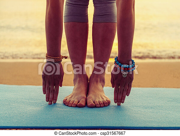 Girl doing yoga exercise on beach