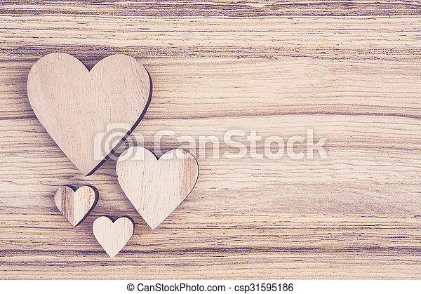 valentine\'s wooden heart on wooden background , valentine\'s day , day valentine postcard with space for text
