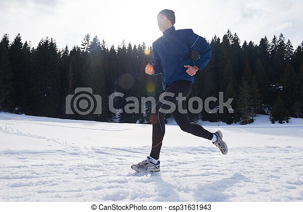 jogging on snow in forest