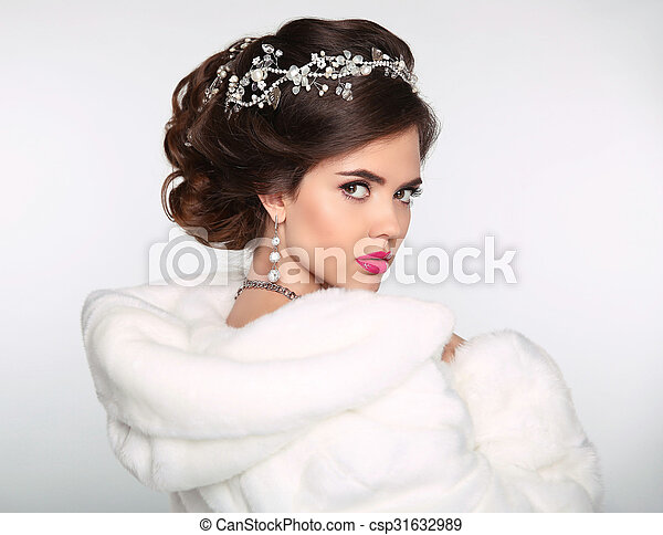 Beauty Fashion Model Girl in white Mink Fur Coat. Wedding hairstyle. Beautiful Luxury Winter Woman isolated on white background.