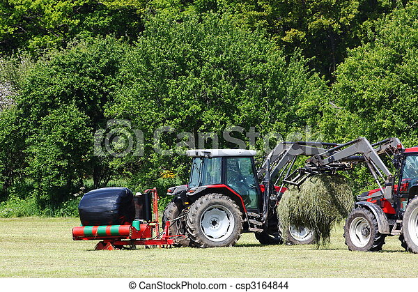 Stock Photo Of Wrapping Hay Bales Two Tractors