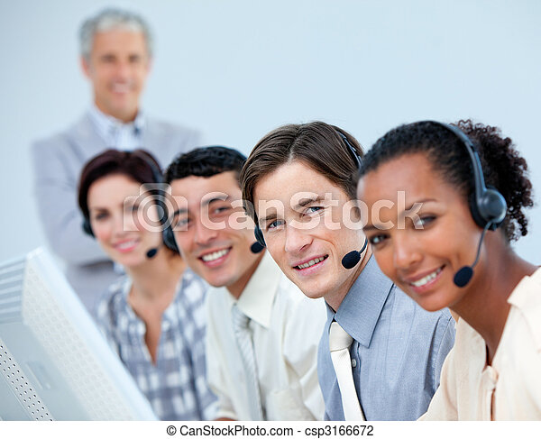 Positive business people using headset in a call center - csp3166672