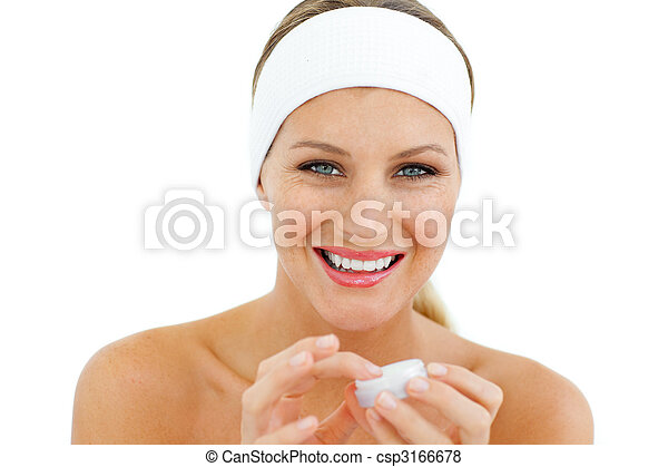 Delighted woman applying lip balm - csp3166678